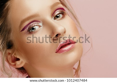 Beauty face of young fashion model woman with bright eyes and lips . Wet blonde hair. Studio #1012407484