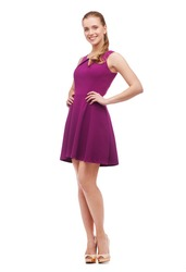 beauty, fashion and happy people concept - young woman in purple dress and high heels