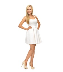beauty, fashion and happy people concept - young woman in white dress and high heels