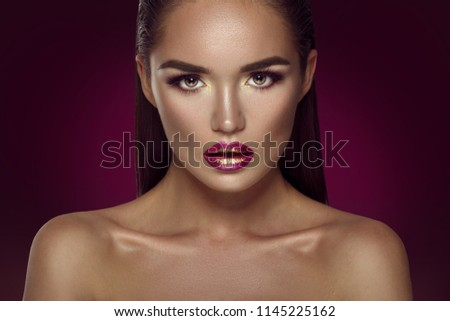 Beauty Fashion brunette model girl portrait. Glamour Sexy woman with perfect trendy makeup, face contouring gradient lips. Beauty trends. On dark red background.