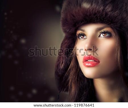 Beauty Fashion Model Girl in a Fur Hat. Beautiful Stylish Woman Portrait.Winter Style Girl. - stock photo