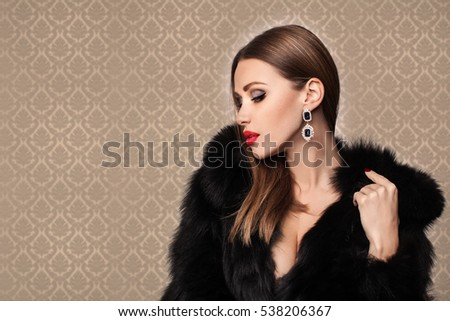 Beauty Fashion Model Girl in Mink Fur Coat. Beautiful Woman in Luxury Brown Fur Jacket . Winter Fashion.  Beauty Fashion Model Girl in Fox Fur Coat. Beautiful Woman in Luxury Red Fur Jacket #538206367