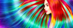 Beauty Fashion Model Girl with Colorful Dyed Hair. Colourful Long Hair. Portrait of a Beautiful Woman with Colorful Dyed Hair, professional hair Coloring. Colouring rainbow hair, bright long haircut