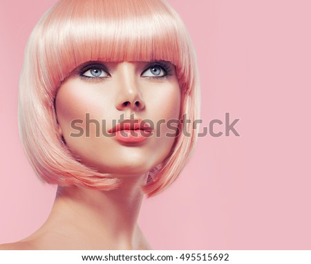 Beauty Fashion Model Portrait pink hair color. Bob Short Haircut. Fringe Hairstyle. Hairdressing. Beautiful Glamour Girl with Short blonde hair. Dyed hair, perfect makeup