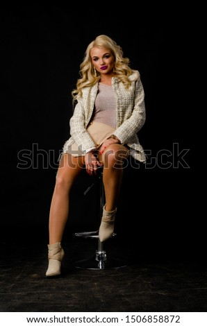 Beauty fashion model portrait with shiny blonde hairstyle with red lips on black background #1506858872