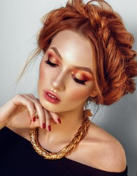 Beauty fashion model with professional make up. Red hair and freckles