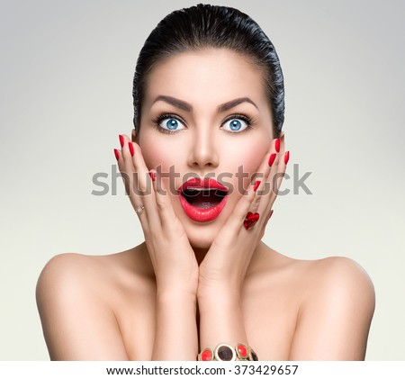 Beauty Fashion surprised Woman portrait. Beautiful model girl with perfect make up exited, screaming and open and mouth. Emotions. Isolated on a white background