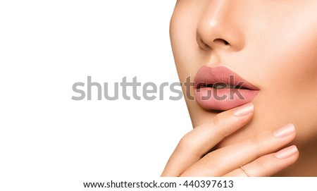 Beauty Fashion woman lips with natural Makeup and beige Nail polish. Matte lipstick and nails. Beauty girl face close up. Nude Colors. Sexy lips, Manicure, Make up. Isolated on a white background #440397613