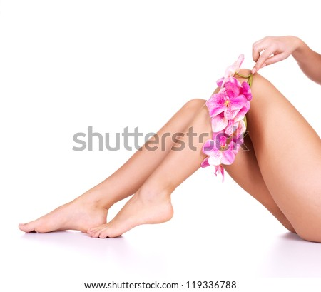 Beauty female slim legs after spa therapy isolated on white