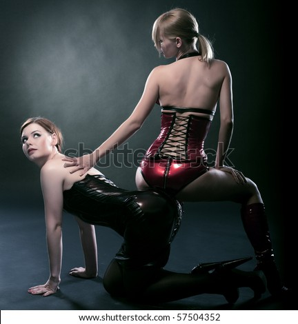 beauty fetish bdsm woman in dresses on black background