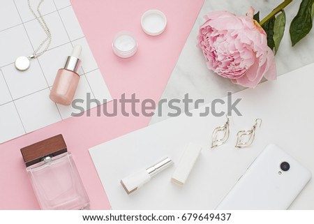 Beauty flat lay with cosmetic bottles, phone and flower. Top view #679649437