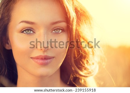 Beauty Fresh Romantic Girl Outdoors. Nature. Sunset. Beautiful Model young Woman face close up. Cute Teenage Girl on the Field Smiling in Sun Light. Glow Sun, Sunshine. Backlit