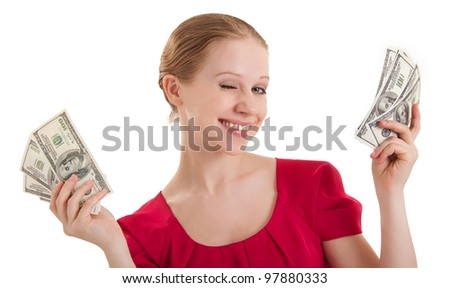 beauty funny girl in a red blouse winks, holds the money, American dollars isolated on a white background