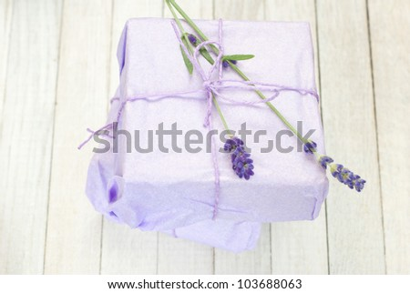 beauty gifts with lavender flowers on white wooden background