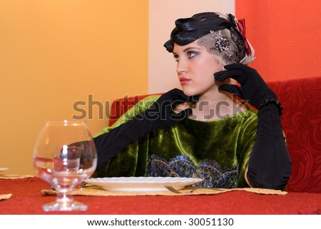 beauty girl at the table with empty plate and glasses