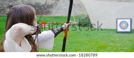 Beauty girl bends bow archer target arrow