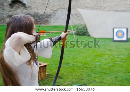 Beauty girl bends bow archer target narrow