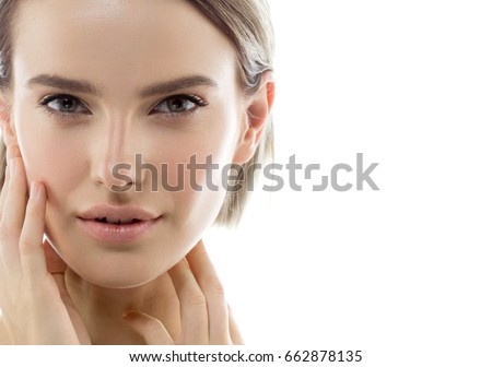 Beauty Girl face Portrait. Beautiful Spa model Woman with Perfect Healthy Hair Smooth. Brunette female with hand touching healthy skin face smiling. Youth and Skin Care Concept