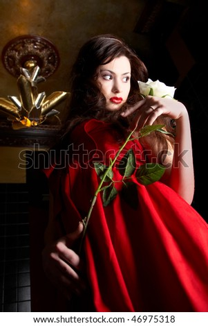 beauty girl in red with white rose