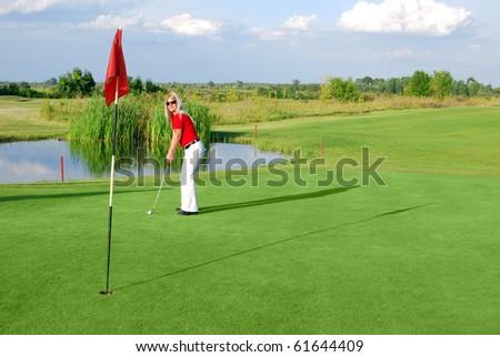 beauty girl play golf - stock photo