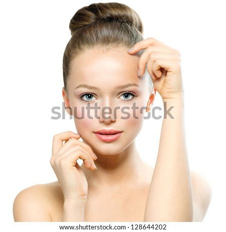 Beauty Girl Portrait. Beautiful Young Woman isolated on White Background. Touching Her Face. Fresh Clean Skin.