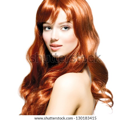 Beauty Girl Portrait. Healthy Long Curly Red Hair. Beautiful Young Woman isolated on a white background