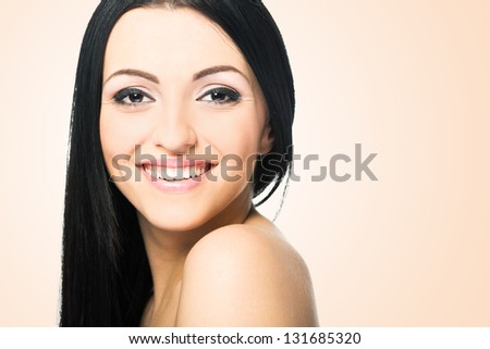 Beauty Girl. Portrait of Beautiful Young Woman looking at Camera.