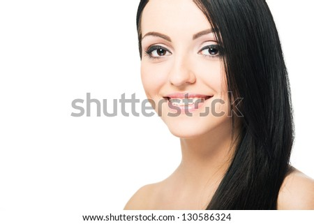 Beauty Girl. Portrait of Beautiful Young Woman looking at Camera. Isolated on White Background. Fresh Clean Skin