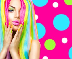 Beauty Girl Portrait with Colorful Makeup, Hair and Nail polish. Colourful Studio Shot of Woman face closeup. Vivid Colors. Manicure and Hairstyle. Rainbow Colors manicure. Dyed hair