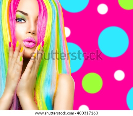 Shutterstock Beauty Girl Portrait with Colorful Makeup, Hair and Nail polish. Colourful Studio Shot of Woman face closeup. Vivid Colors. Manicure and Hairstyle. Rainbow Colors manicure. Dyed hair