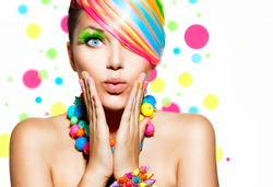 Beauty Girl Portrait with Colorful Makeup, Hair, Nail polish and Accessories. Colourful Studio Shot of Funny Surprised Woman. Vivid Colors
