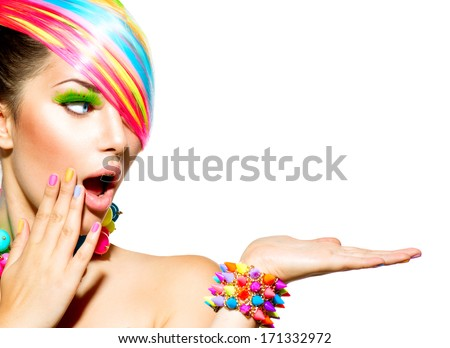 Beauty Girl Portrait with Colorful Makeup, Hair, Nail polish and Accessories. Colourful Studio Shot of Funny Woman. Vivid Colors. Manicure and Hairstyle. Rainbow Colors  - stock photo