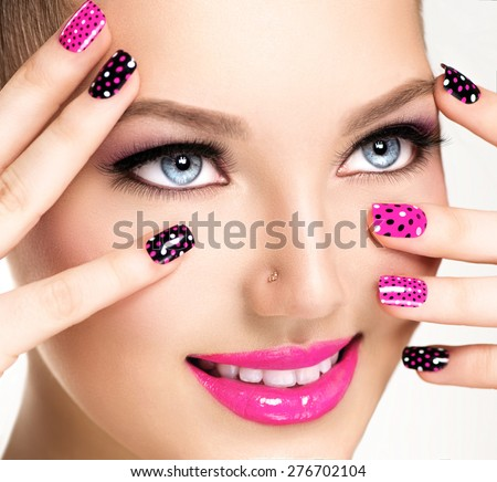 Shutterstock Beauty Girl Portrait with Vivid Makeup and colorful Nail polish. Colourful nails. Fashion Woman portrait close up. Bright Colors. Manicure Make up. Smoky eyes, long eyelashes. Rainbow Colors