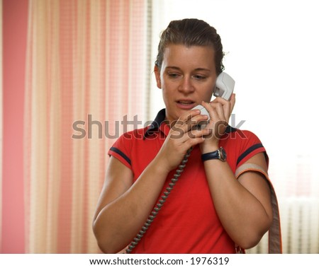 Beauty girl speaking on the phone. Girl holding a phone