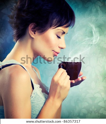 Beauty Girl With Cup of Coffee