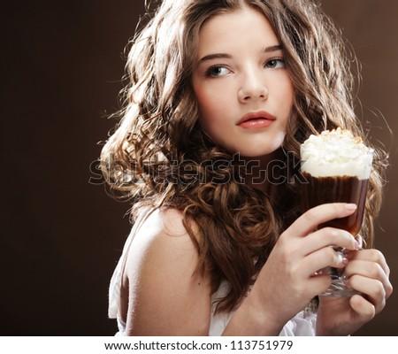 beauty girl with glass of coffee witn cream