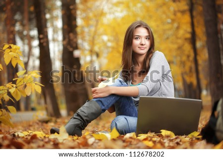 beauty girl with laptop outdoors - stock photo