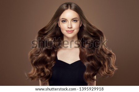 Beauty girl with long  and   shiny wavy hair .  Beautiful   woman model with curly hairstyle . #1395929918