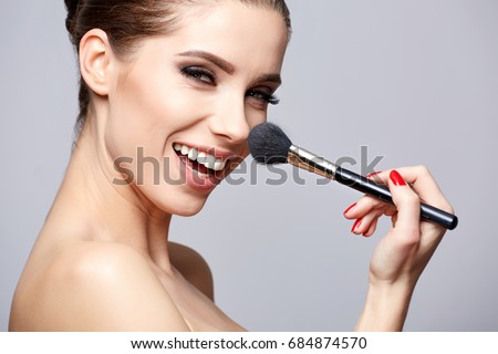 Beauty Girl with Makeup Brushes. Make-up for Brunette Woman. Beauty Face with smile