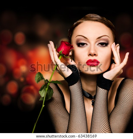 Beauty girl with rose against an abstract dark background