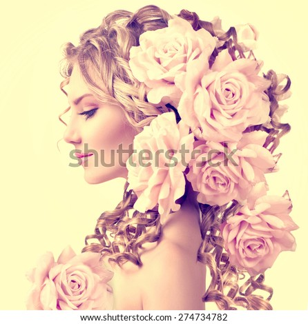 Beauty girl with rose flowers hairstyle isolated on white background. Fashion model  woman portrait with pink flowers. Summer fairy portrait. Long permed curly hair. Perfect make up