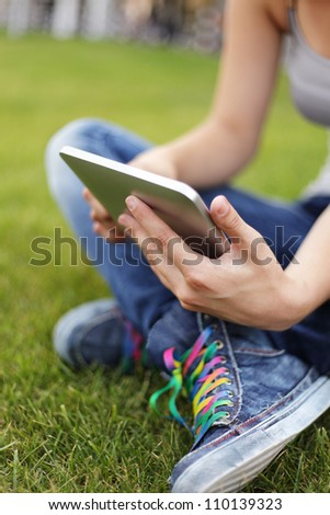 Beauty girl with tablet PC outdoors