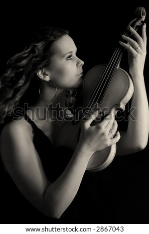 Beauty girl with violin over black background. Black&white - stock photo