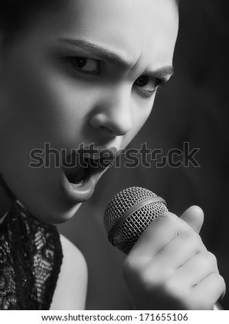 Beauty glamor singer girl n with microphone