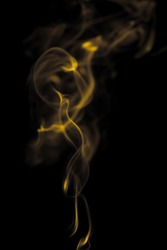 Beauty gold smoke on dark background, movement golden of fire flame smoke, Abstract and texture of amazing magic gold smoke on black background