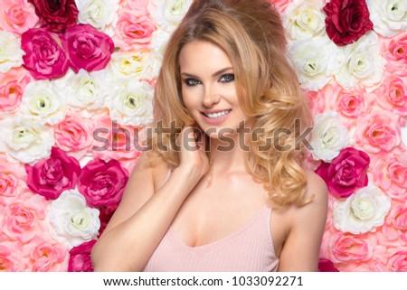 Beauty happy model girl with flowers. Hair like brigitte bardot
