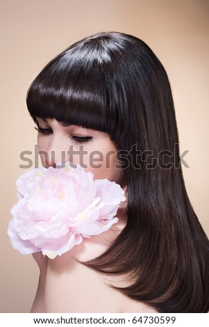 Beauty Head-shot of young fashion model with straight brown hair.