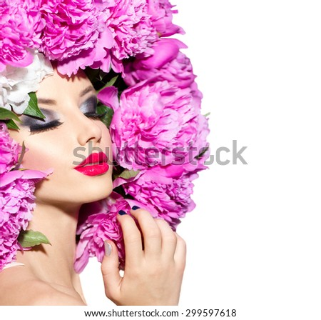 Beauty High Fashion Model Girl with pink Peony hair style. Vivid Make up. Beautiful Model woman with Blooming flowers on head. Nature Hairstyle.  Holiday Creative Makeup. Isolated on white background
