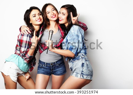 beauty hipster girls with a microphone singing and having fun #393251974