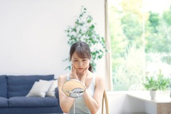 beauty image,  Asian woman  being concerned with the mirror